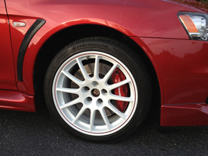 A red car with white rims